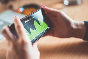 young woman analyzing website traffic earnings chart on iphone picjumbo com
